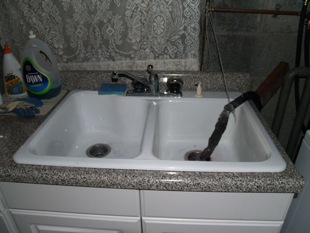 washing machine drain hose into sink